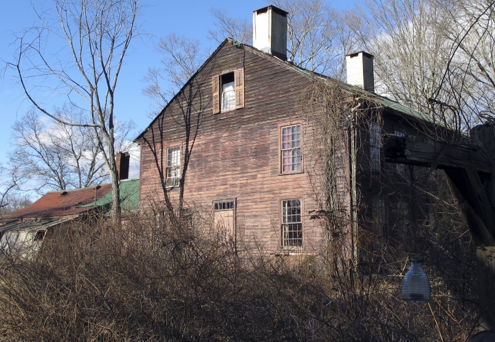 The 18th century home of the late famed herbalist Adelma Grenier Simmons sits on the Caprilands herb farm, Thursday, Jan. 3, 2019, in Coventry, Conn. Simmons, who died in 1997 at age 93, is credited with reintroducing and popularizing the use of herbs in American cooking. Her widower Edward Cook, accused of failing to maintain the property, is fighting an eviction order. (AP Photo/Dave Collins)