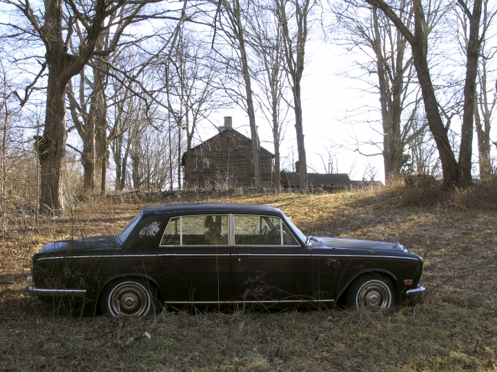 A Rolls-Royce automobile sits on the Caprilands herb farm of the late famed herbalist Adelma Grenier Simmons, Thursday, Jan. 3, 2019, in Coventry, Conn. Simmons, who died in 1997 at age 93, is credited with reintroducing and popularizing the use of herbs in American cooking. Her widower Edward Cook, accused of failing to maintain the property, is fighting an eviction order. (AP Photo/Dave Collins)