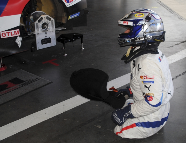 Alex Zanardi is shown in the garage at Daytona International Speedway in Daytona Beach, Fla., Friday, Jan. 4, 2018, where he is preparing for the Rolex 24, an endurance race at Daytona in late January. Zanardi is still racing 17 years after both his legs were severed in a crash. The Italian is now behind the wheel of a BMW that has been customized for Zanardi to race without his prosthetic legs. (AP Photo/Mark Long)