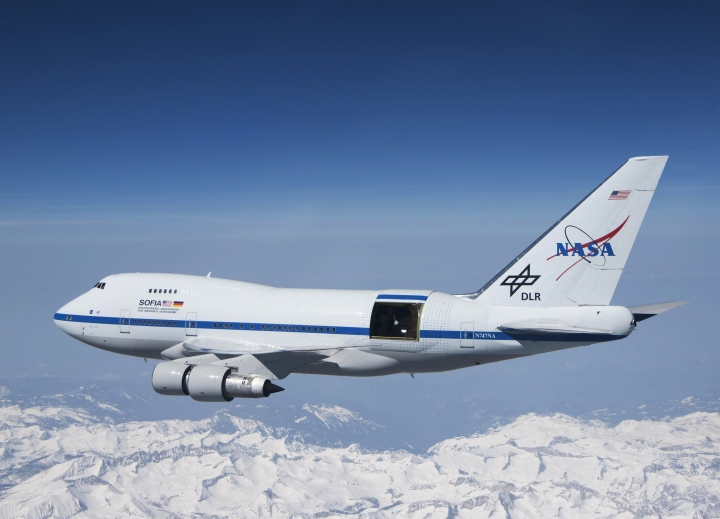 "This undated photo provided by NASA shows SOFIA over the snow-covered Sierra Nevada mountains with its telescope door open during a test flight. The world's largest airborne observatory was supposed to be parked in Seattle this week, so thousands of scientists attending the ""Super Bowl of Astronomy"" could behold this marvel: a Boeing 747, like this one shown, for example, outfitted with a massive telescope used to study the fundamental mysteries of the universe. (Jim Ross/NASA via AP)"