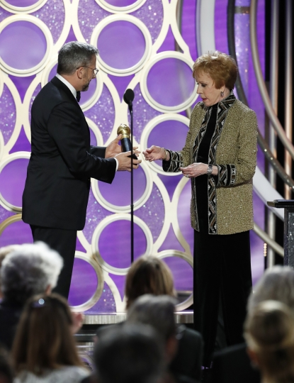 This image released by NBC shows Carol Burnett accepting the inaugural Carol Burnett TV Achievement Award from presenter Steve Carell during the 76th Annual Golden Globe Awards at the Beverly Hilton Hotel on Sunday, Jan. 6, 2019 in Beverly Hills, Calif. (Paul Drinkwater/NBC via AP)