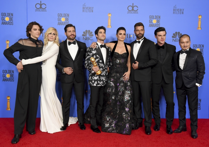 """The cast of """"The Assassination of Gianni Versace: American Crime Story"""" poses in the press room with the award for best television limited series or motion picture made for television at the 76th annual Golden Globe Awards at the Beverly Hilton Hotel on Sunday, Jan. 6, 2019, in Beverly Hills, Calif. Pictured from left are Cody Fern, Judith Light, Edgar Ramirez, Darren Criss, Penelope Cruz, Ricky Martin, Finn Wittrock and Jon Jon Briones. (Photo by Jordan Strauss/Invision/AP)"""