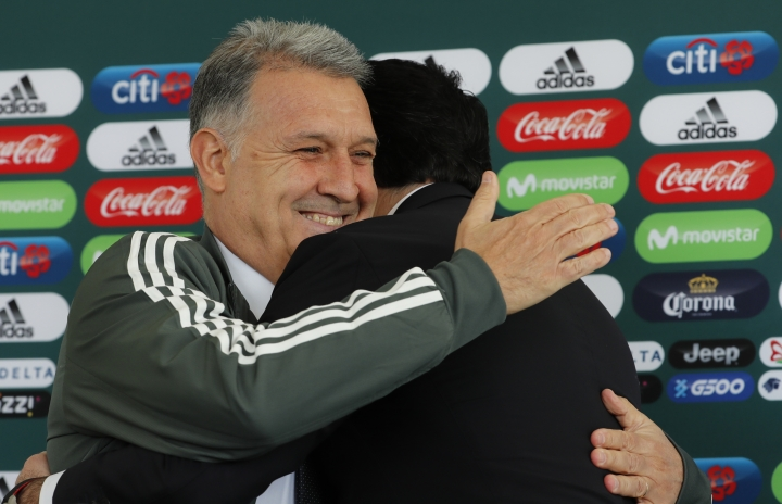 Gerardo Martino is presented as the new coach of Mexico's national soccer team, during a news conference in Mexico City, Monday, Jan. 7, 2019. At right is Yon De Luisa, president of the Mexican Football Federation. (AP Photo/Marco Ugarte)