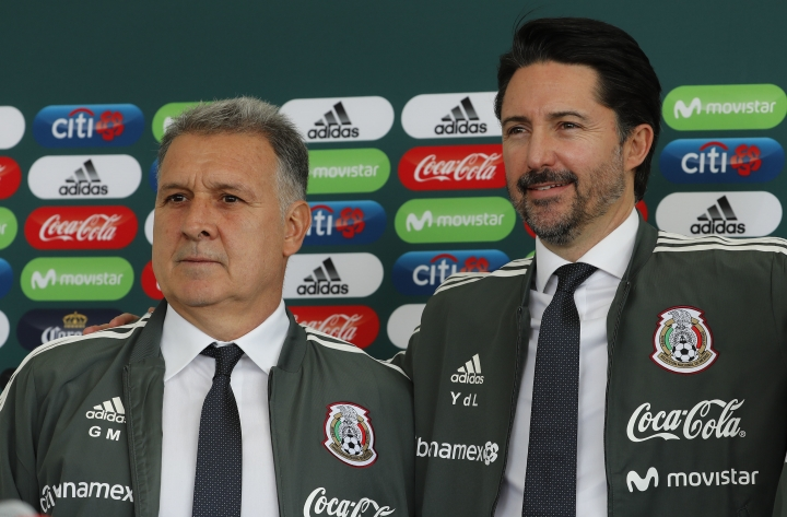 Mexico's new soccer coach Gerardo Martino, left, stands with Mexican Football Federation President Yon De Luisa during the news conference where Martino was presented as the coach in Mexico City, Monday, Jan. 7, 2019. (AP Photo/Marco Ugarte)