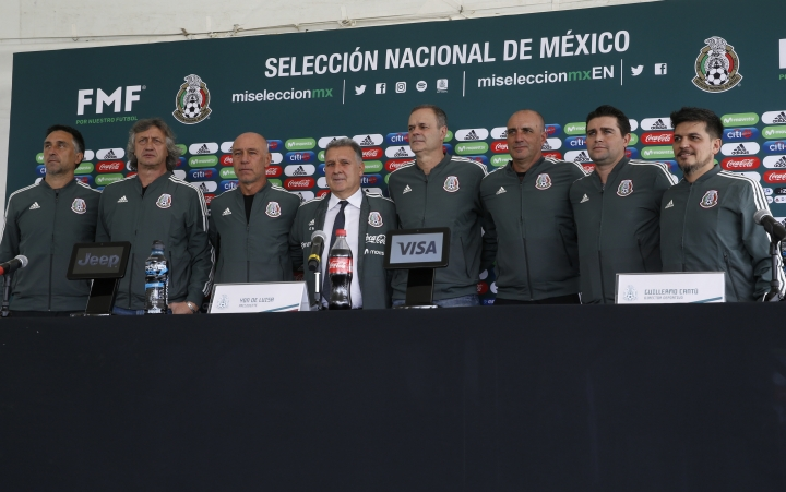 Gerardo Martino, center wearing a tie, is presented as the new coach of Mexico's national soccer team, along with the team's new technical staff, as they pose for photos during a press conference in Mexico City, Monday, Jan. 7, 2019. (AP Photo/Marco Ugarte)