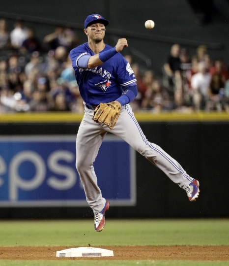 "FILE - In this July 20, 2016, file photo, Toronto Blue Jays' Troy Tulowitzki throws out Arizona Diamondbacks' Brandon Drury during the fourth inning of an interleague baseball game, in Phoenix. Tulowitzki would be happy to have the New York Yankees add Manny Machado to their infield, even if the move costs the 34-year-old shortstop playing time. ""Hey, I signed up to be a Yankee because I wanted to play with the best players,"" Tulowitzki said Monday, ""so if Manny is one of those guys, then I think that would be awesome, It would make the team that much stronger."" (AP Photo/Matt York, File)"