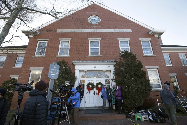 Members of the news media stand outside the Nantucket Town & County Building, awaiting arrival of actor Kevin Spacey for arraignment on a charge of indecent assault and battery, Monday, Jan. 7, 2019, in Nantucket, Mass. The Oscar-winning actor is accused of groping the teenage son of a former Boston TV anchor in 2016 in the crowded bar at the Club Car in Nantucket. (AP Photo/Steven Senne)