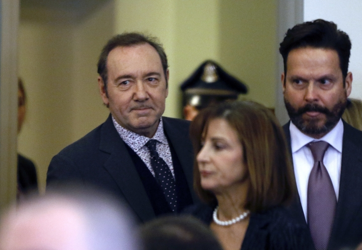 Actor Kevin Spacey enters the courtroom with his attorneys Juliane Balliro, front, and Alan Jackson, right, for arraignment on a charge of indecent assault and battery on Monday, Jan. 7, 2019, in district court in Nantucket, Mass. The Oscar-winning actor is accused of groping the teenage son of a former Boston TV anchor in 2016 in the crowded bar at the Club Car in Nantucket. (Nicole Harnishfeger/The Inquirer and Mirror via AP, Pool)