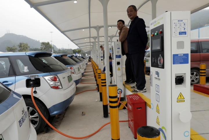 In this Monday, Jan. 7, 2019, photo, new electric-powered taxis are charged at a public charging station in Shenzhen city, south China's Guangdong province. One of China's major cities has reached an environmental milestone, an almost all electric-powered taxi fleet. The high-tech hub of Shenzhen in southern China announced at the start of this year that 99 percent of the 21,689 taxis operating in the city were electric. (AP Photo/Vincent Yu)