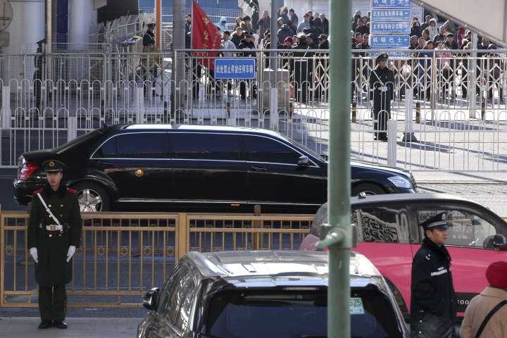 A stretch limousine with a golden emblem, similar to one North Korean leader Kim Jong Un has used previously, is seen leaving the train station with a convoy in Beijing, China, Tuesday, Jan. 8, 2019. North Korean leader Kim Jong Un is making a four-day trip to China, the North's state media reported Tuesday, in what's likely an effort by Kim to coordinate with his only major ally ahead of a summit with U.S. President Donald Trump that could happen early this year. (AP Photo/Ng Han Guan)
