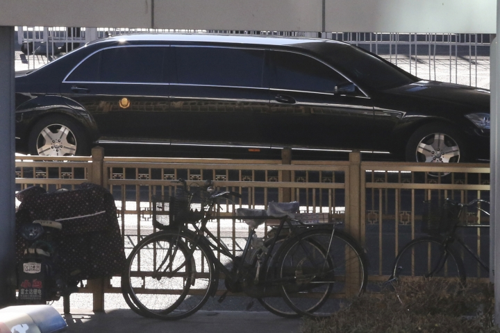 A stretch limousine with a golden emblem, similar to one North Korean leader Kim Jong Un has used previously, leaves a train station with a convoy in Beijing, China, Tuesday, Jan. 8, 2019. North Korean leader Kim Jong Un is making a four-day trip to China, the North's state media reported Tuesday, in what's likely an effort by Kim to coordinate with his only major ally ahead of a summit with U.S. President Donald Trump that could happen early this year. (AP Photo/Ng Han Guan)