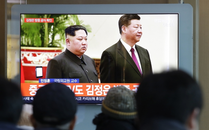 People watch a TV screen showing file footage of North Korean leader Kim Jong Un and Chinese President Xi Jinping, right, during a news program at the Seoul Railway Station in Seoul, South Korea, Tuesday, Jan. 8, 2019. Kim is making a four-day trip to China, the North's state media reported Tuesday, in what's likely an effort by Kim to coordinate with his only major ally ahead of a summit with U.S. President Donald Trump that could happen early this year. (AP Photo/Ahn Young-joon)