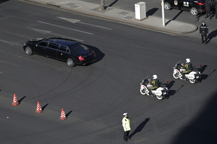 A stretch limousine with a golden emblem, similar to one North Korean leader Kim Jong Un has used previously, is escorted by motorcades traveling towards Diaoyutai State Guesthouse in Beijing, Tuesday, Jan. 8, 2019. Kim is making a four-day trip to China, the North's state media reported Tuesday, in what's likely an effort by Kim to coordinate with his only major ally ahead of a summit with U.S. President Donald Trump that could happen early this year. (AP Photo/Andy Wong)