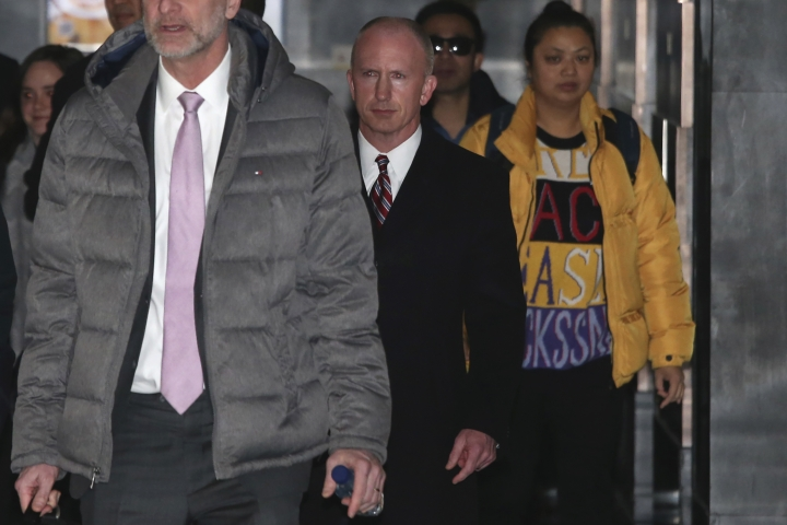 Deputy U.S. trade representative, Jeffrey D. Gerrish, center, who is leading a U.S. trade delegation leaves from a hotel for a second day of meetings with Chinese officials in Beijing, China, Tuesday, Jan. 8, 2019. Facing a March deadline, talks aimed at ending a trade war between China and the U.S. are underway, with the world's two biggest economies expressing optimism over the potential for progress but neither indicating its stance has changed. (AP Photo/Ng Han Guan)