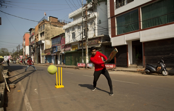 Indian boys play cricket on a deserted street during an eleven hour general strike called by All Assam Students' Union (AASU) and North East Students' Organization (NESO) in Gauhati, India, Tuesday, Jan. 8, 2019. India's populous northeast saw a near-total shutdown Tuesday with sporadic incidents of violence as federal Home Minister Rajnath Singh introduced a bill in the lower house of Parliament to grant citizenship to non-Muslim migrants who may have fled to India in the wake of alleged persecution in Pakistan, Afghanistan and Bangladesh. (AP Photo/Anupam Nath)