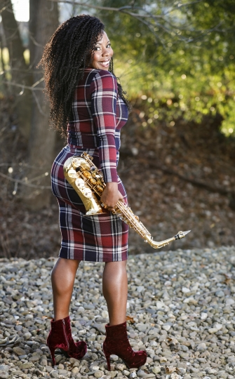 This Jan. 6, 2019 photo shows saxophonist Tia Fuller posing in Piscataway, N.J. Fuller, who teaches at Berklee College of Music and famously toured with Beyonce as part of her all-female band, is nominated for her first Grammy in the best instrumental jazz album category. (Photo by Brian Ach/Invision/AP)
