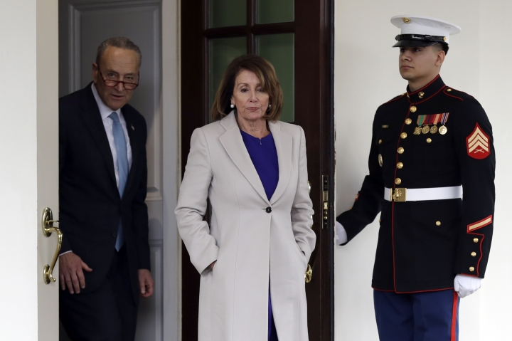 Senate Minority Leader Chuck Schumer of N.Y., and Speaker of the House Nancy Pelosi of Calif., walk from the West Wing to speak to reporters after meeting with President Donald Trump about border security in the Situation Room of the White House, Friday, Jan. 4, 2018, in Washington. (AP Photo/Evan Vucci)
