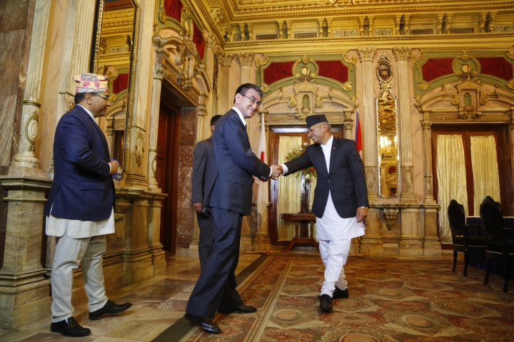 Japanese Foreign Minister Taro Kono, center is welcomed by Nepalese Minister for Foreign Affairs Pradeep Gyawali during a bilateral meeting in Kathmandu, Nepal, Wednesday, Jan. 9, 2019. (AP Photo/Niranjan Shrestha)