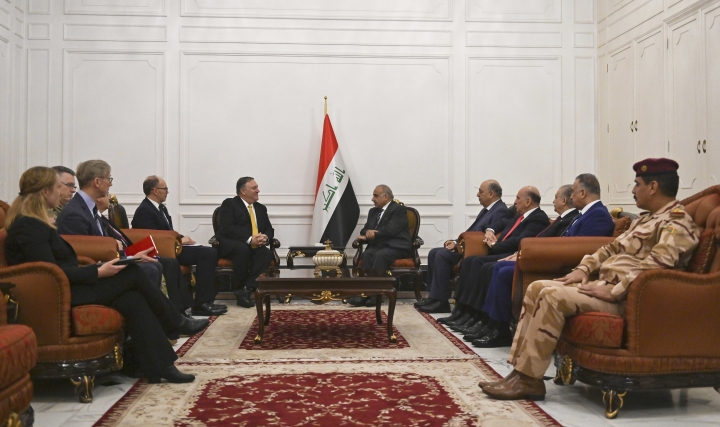 U.S. Secretary of State Mike Pompeo, center left, meets with Iraqi Prime Minister Adel Abdul-Mahdi, center right, and their delegations, in Baghdad, Iraq, Wednesday, Jan. 9, 2019. Pompeo visited Iraq on an unannounced stop on his Mideast tour. The U.S. diplomat is touring American allies in the region amid confusion over conflicting statements by President Donald Trump and senior U.S. officials about a planned U.S. troop withdrawal from Syria. (Andrew Caballero-Reynolds/Pool via AP)