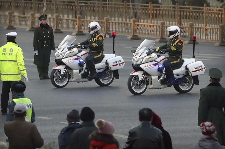 Chinese paramilitary police on motorcycles escort a motorcade believed to be carrying North Korean leader Kim Jong Un passes along a street in Beijing, Wednesday, Jan. 9, 2019. North Korean state media reported Tuesday that Kim is making a four-day trip to China in what's likely an effort by him to coordinate with his only major ally ahead of a summit with U.S. President Donald Trump that could happen early this year. (AP Photo/Mark Schiefelbein)