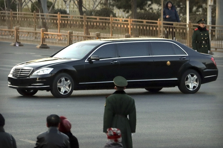 Security officials stand guard while a Mercedes limousine in a motorcade believed to be carrying North Korean leader Kim Jong Un passes along a street in Beijing, Wednesday, Jan. 9, 2019. North Korean state media reported Tuesday that Kim is making a four-day trip to China in what's likely an effort by him to coordinate with his only major ally ahead of a summit with U.S. President Donald Trump that could happen early this year. (AP Photo/Mark Schiefelbein)