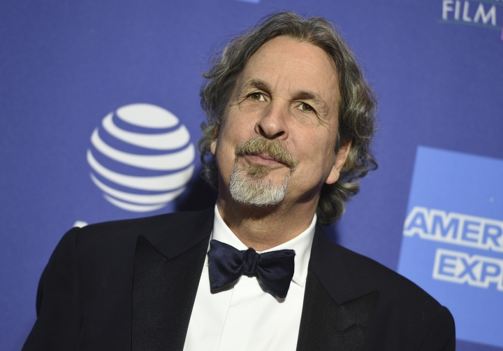 "FILE - In this Thursday, Jan. 3, 2019 file photo, Peter Farrelly arrives at the 30th annual Palm Springs International Film Festival in Palm Springs, Calif. Green Book"" director Farrelly says he's deeply sorry and embarrassed after film website The Cut found an old story where colleagues said Farrelly liked to flash his genitals as a joke. The Cut on Wednesday, Jan. 9, 2019, published excerpts of a 1998 Newsweek story saying Farrelly liked to use ruses to get people to look at his penis. (Photo by Jordan Strauss/Invision/AP, File)"