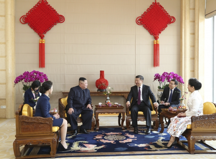 In this Wednesday, Jan. 9, 2019, photo released by China's Xinhua News Agency, North Korean leader Kim Jong Un, third from left, and his wife Ri Sol Ju, second from left, and Chinese President Xi Jinping, third from right, and his wife Peng Liyuan, far right, attend a meeting at the Beijing Hotel in Beijing. A special train believed to be carrying Kim Jong Un departed Beijing on Wednesday after a two-day visit by the North Korean leader to the Chinese capital. (Huang Jingwen/Xinhua via AP)