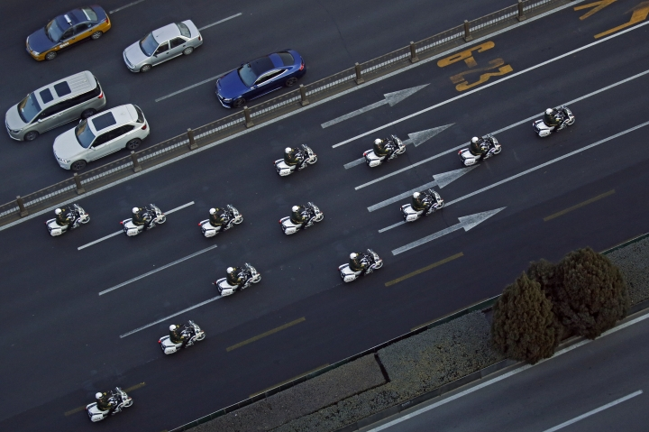 Chinese paramilitary policemen on motorcycles escort a motorcade believed to be carrying North Korean leader Kim Jong Un traveling past Chang'an Avenue in Beijing, Wednesday, Jan. 9, 2019. North Korean state media reported Tuesday that Kim is making a four-day trip to China in what's likely an effort by him to coordinate with his only major ally ahead of a summit with U.S. President Donald Trump that could happen early this year. (AP Photo/Andy Wong)
