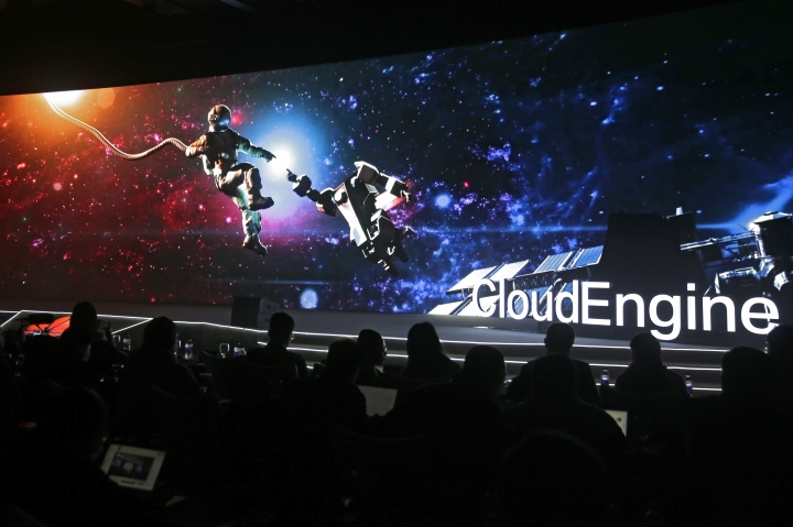 """In this Wednesday, Jan. 9, 2019, photo, invited guests watch a video presentation showing an astronaut making contact with a robot during a new product """"CloudEngine 16800 Built for the AI Era"""" by laugh by Huawei at a hotel in Beijing. The United States says talks in Beijing on ending a bruising trade war focused on Chinese promises to buy more American goods. But it gave no indication of progress on resolving disputes over Beijing's technology ambitions and other thorny issues. (AP Photo/Andy Wong)"""