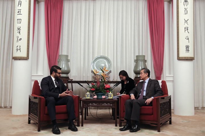 Afghanistan National Security Advisor Hamdullah Mohib, left, talks to the Chinese Foreign Minister Wang Yi during their meeting at the Zhongnanhai Leadership Compound in Beijing, Thursday, Jan. 10, 2019. (AP Photo/Andy Wong, Pool)