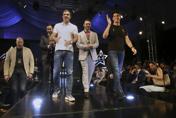 Brazilian soccer player Ricardo Kaka, right, and Portugal soccer player Luis Figo, third left, wave to participants during a ceremony in Karachi, Pakistan, Thursday, Jan. 10, 2019. Soccer greats Figo and Kaka arrived in Pakistan to launch World Soccer Stars event in a country known for his passion about game of cricket. (AP Photo/Fareed Khan)