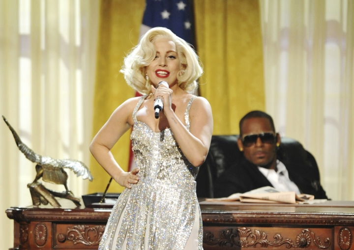 """FILE - In this Nov. 24, 2013 file photo, Lady Gaga, center, and R. Kelly perform """"Do What U Want (With My Body)"""" at the American Music Awards in Los Angeles. Lady Gaga is sorry for her 2013 duet with R. Kelly in the wake of sexual misconduct allegations against the singer, and she intends to remove the song from streaming services. (Photo by John Shearer/Invision/AP, file)"""