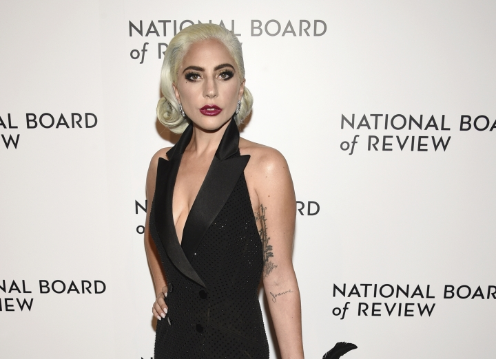 "FILE - In this Jan. 8, 2019 file photo, Lady Gaga attends the National Board of Review Awards gala at Cipriani 42nd Street in New York. Lady Gaga is sorry for her 2013 duet with singer R. Kelly in the wake of sexual misconduct allegations against the rapper and she intends to remove the song from streaming services. Posting on Twitter Wednesday, Jan. 9Gaga wrote she had collaborated with Kelly on ""Do What U Want (With My Body)"" during a ""dark time"" in her life as a victim of sexual assault. She said she should have sought therapy or other help instead.(Photo by Evan Agostini/Invision/AP, File)"