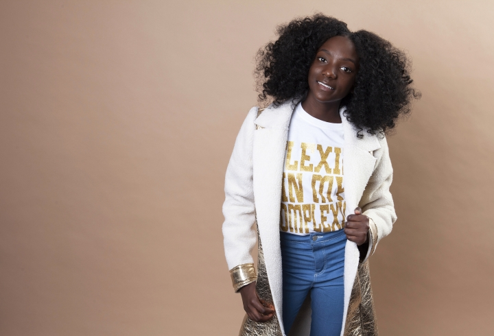 "In this Dec. 19, 2018 photo, social media personality Kheris Rogers poses for a portrait in Los Angeles. Rogers launched her own fashion line with T-shirts sporting, ""Flexin' in My Complexion,"" along with backpacks reading ""The Miseducation of Melanin"" and other apparel and accessories. (Photo by Rebecca Cabage/Invision/AP)"