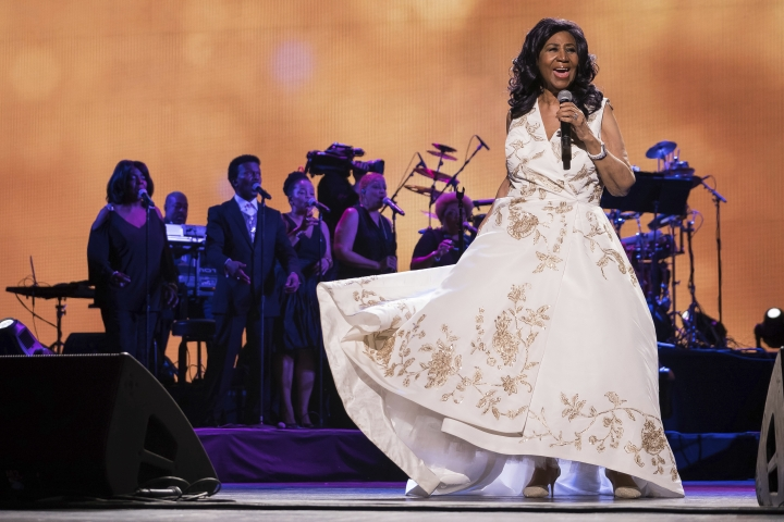 "FILE - In this April 19, 2017, file photo, Aretha Franklin performs at the world premiere of ""Clive Davis: The Soundtrack of Our Lives"" at Radio City Music Hall, during the 2017 Tribeca Film Festival, in New York. The long-gesticulating Franklin biopic ""Respect"" is going ahead with stage director Liesel Tommy set to direct. (Photo by Charles Sykes/Invision/AP, File)"