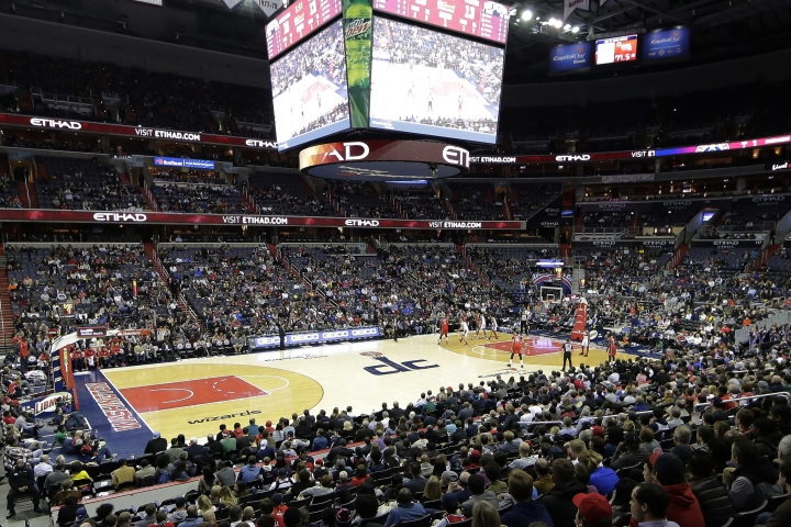 FILE - In this Dec. 19, 2017, file photo, the New Orleans Pelicans and the Washington Wizards play in an NBA basketball game in Washington. A new, gambling-focused telecast of Wizards games is just the appetizer to what the team and its TV partner hope will be a more substantial main course: giving fans the ability to place bets in real time while watching games at home. Whether that idea comes to fruition will depend on laws in the states where Wizards games are shown on the regional network NBC Sports Washington. But the concept shows how legal sports betting continues to change the way sports are presented to the public. (AP Photo/Mark Tenally, File)
