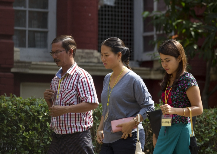 Pan Ei Mon, center, wife of Reuters journalist Wa Lone, walks together with Chit Su Win, right, wife of Reuters journalist Kyaw Soe Oo, upon arrival at the High Court in Yangon, Myanmar Friday, Jan. 11, 2019. A court in Myanmar on Friday rejected the appeal of two Reuters journalists convicted of violating the country's Official Secrets Act during their reporting on the country's crackdown on Rohingya Muslims, and maintained the seven-year prison terms they were sentenced to last year. (AP Photo/Thein Zaw)