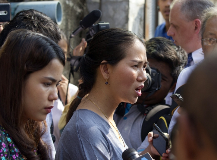 Pan Ei Mon, center, wife of Reuters journalist Wa Lone, talks to journalists as she leaves the High Court along with Chit Su Win, left, wife of Reuters journalist Kyaw Soe Oo, in Yangon, Myanmar Friday, Jan. 11, 2019. A court in Myanmar on Friday rejected the appeal of two Reuters journalists convicted of violating the country's Official Secrets Act during their reporting on the country's crackdown on Rohingya Muslims, and maintained the seven-year prison terms they were sentenced to last year. (AP Photo/Thein Zaw)