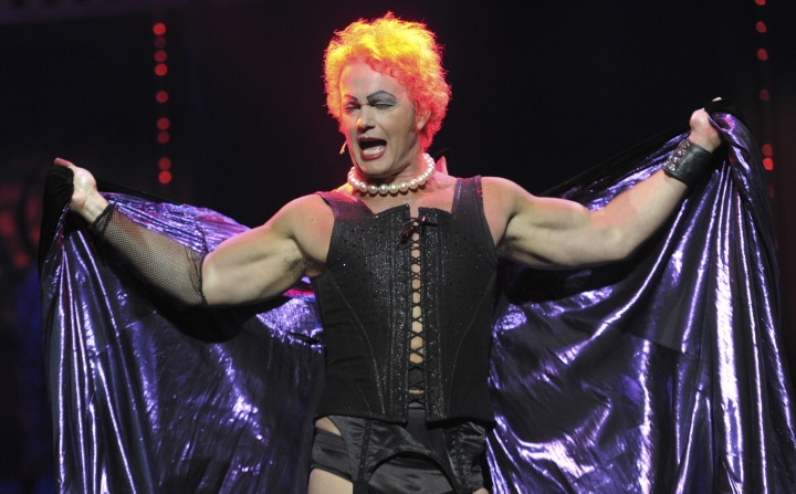 In this April 23, 2014, photo, Craig McLachlan performs as Frank N Furter during a media call for The Rocky Horror Show at the Comedy Theatre in Melbourne. Police in Victoria state on Friday, Jan. 11, 2019, said a 53-year-old man, identified by news outlets as McLachlan, had been charged on summons to appear in court over the nine charges, and another charge of attempted indecent assault.(Julian Smith/AAP Image via AP)