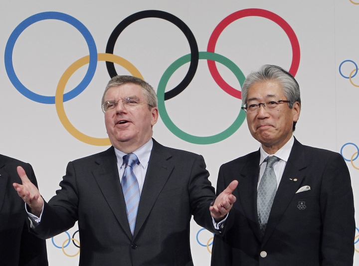 "FILE - This Nov. 20, 2013, file photo shows Japan Olympic Committee President Tsunekazu Takeda, right, and International Olympic Committee (IOC) President Thomas Bach, left, following a press conference in Tokyo. France's financial crimes office says International Olympic Committee member Takeda is being investigated for corruption related to the 2020 Tokyo Olympics. The National Financial Prosecutors office says Takeda, the president of the Japanese Olympic Committee, was placed under formal investigation for ""active corruption"" on Dec. 10.(AP Photo/Junji Kurokawa, File)"
