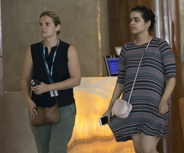 Rahaf Mohammed Alqunun, right, walks with an unidentified companion in Bangkok, Thailand, Friday, Jan. 11, 2019. Alqunun, the 18-year old Saudi woman who fled her family to seek asylum, remains in Thailand under the care of the U.N. refugee agency as she awaits a decision by a third country to accept her as a refugee. (AP Photo/Sakchai Lalit)