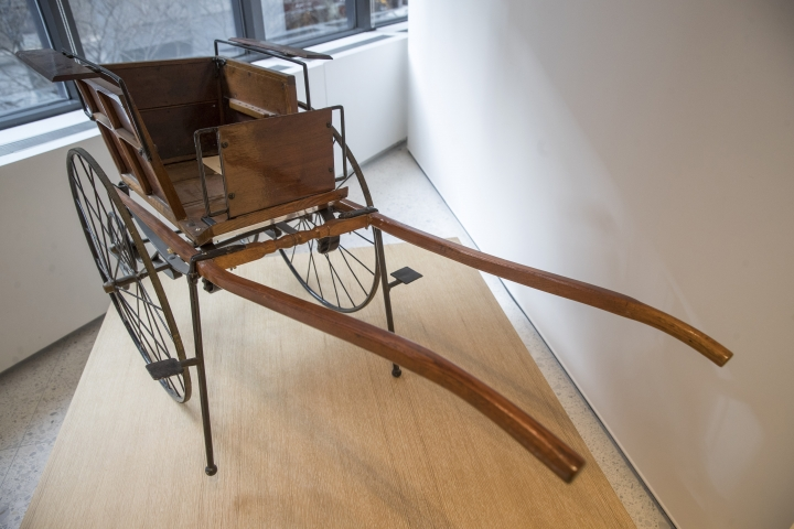 This Wednesday, Jan. 9, 2019, photo shows a Victorian Child's Dog Cart on display at the American Kennel Club Museum of the Dog in New York. The museum opens Feb. 8. (AP Photo/Mary Altaffer)