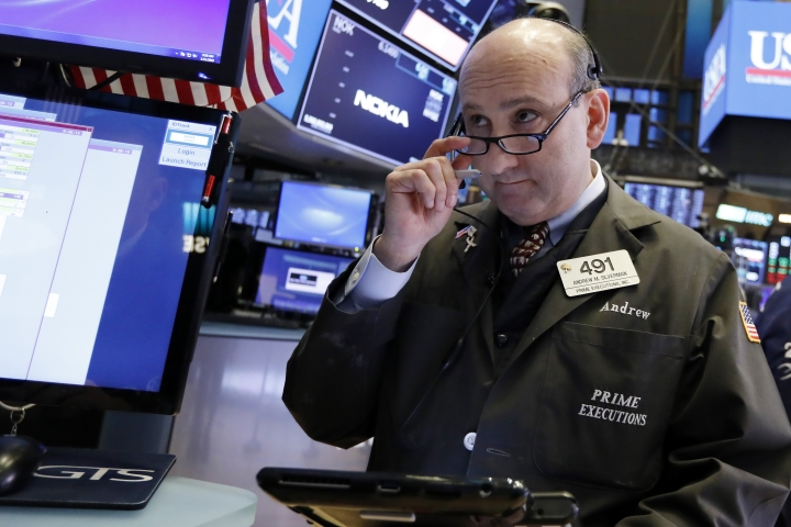 Trader Andrew Silverman works on the floor of the New York Stock Exchange, Friday, Jan. 11, 2019. Stocks are opening broadly lower on Wall Street, led by declines in banks and technology companies. (AP Photo/Richard Drew)
