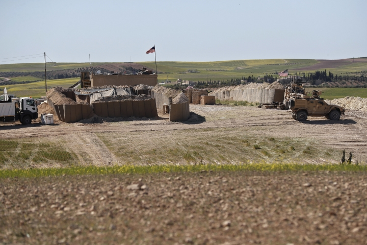 FILE - In this Wednesday, April 4, 2018 file photo, a U.S. position, installed near the front line between the U.S-backed Syrian Manbij Military Council and the Turkish-backed fighters, in Manbij, north Syria. An American military official said Friday, Jan. 11, 2019 that the U.S.-led military coalition has begun the process of withdrawing troops from Syria. (AP Photo/Hussein Malla, File)