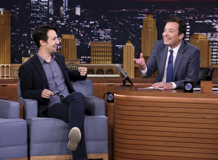 "This Oct. 4, 2016 image released by NBC shows Lin-Manuel Miranda during an interview with host Jimmy Fallon on ""The Tonight Show Starring Jimmy Fallon,"" in New York. Fallon's ""Tonight Show"" broadcast from Puerto Rico on Jan. 15, will showcase artists with ties to the U.S. territory. Besides previously announced Miranda, Fallon will be joined on the show by Jose Feliciano, Bad Bunny and Ozuna. (Andrew Lipovsky/NBCU Photo Bank via AP)"