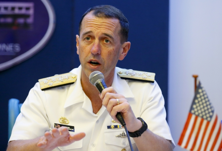 FILE - In this Oct. 29, 2018, file photo, Adm. John Richardson, chief of Naval Operations of the U.S. Navy, speaks during a news conference with Philippine Armed Forces Chief Gen. Carlito Galvez Jr., following their meeting at Camp Aguinaldo in suburban Quezon city, Philippines. The U.S. Navy's top officer will visit China starting Sunday, Jan. 13, 2019, amid increasing frictions in the South China Sea and other issues underscoring their rivalry for dominance in Asia. (AP Photo/Bullit Marquez, File)