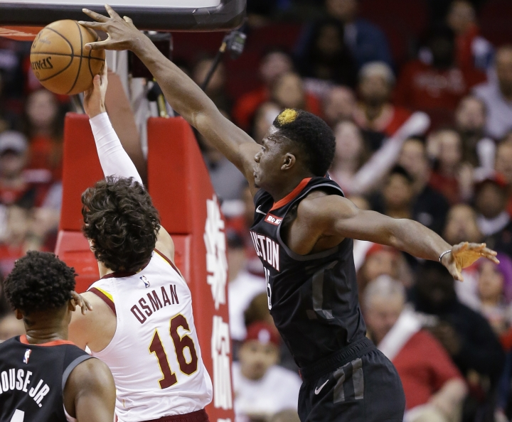 Houston Rockets center Clint Capela, right, blocks the shot of Cleveland Cavaliers forward Cedi Osman (16) during the first half of an NBA basketball game Friday, Jan. 11, 2019, in Houston. (AP Photo/Eric Christian Smith)