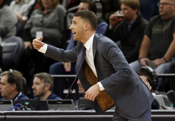 Minnesota Timberwolves interim head coach Ryan Saunders, making his home court debut, directs his players against the Dallas Mavericks in the first half of an NBA basketball game Friday, Jan. 11, 2019, in Minneapolis. Saunders replaces the fired Tom Thibodeau. (AP Photo/Jim Mone)