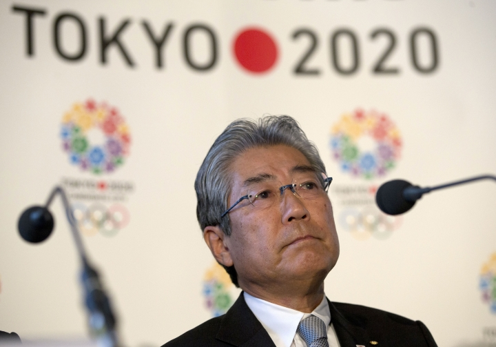 """FILE - This is a Thursday, Jan. 10, 2013 file photo of Tsunekazu Takeda, President of the Tokyo 2020 Olympic games bid, as he listens to a question from the media during their first international presentation of the Tokyo 2020 Olympic Games bid in London. France's financial crimes office says International Olympic Committee member Takeda is being investigated for corruption related to the 2020 Tokyo Olympics. The National Financial Prosecutors office says Takeda, the president of the Japanese Olympic Committee, was placed under formal investigation for """"active corruption"""" on Dec. 10.(AP Photo/Alastair Grant, File)"""