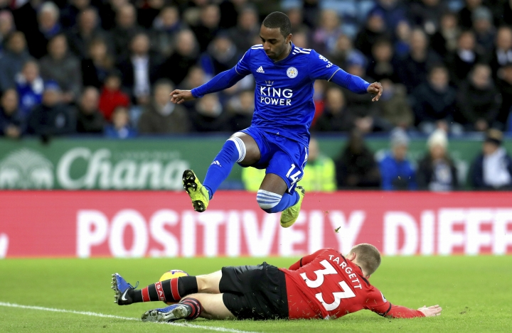 Leicester City's Ricardo Pereira, top, and Southampton's Matt Targett battle for the ball during the English Premier League soccer match at the King Power Stadium, Leicester, England, Saturday Jan. 12, 2019. (Mike Egerton/PA via AP)